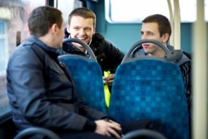 Group of lads having fun on bus