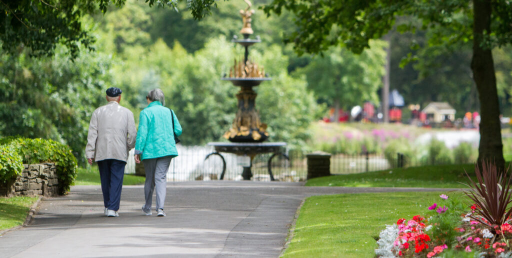 Image of couple walking in a park