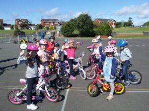 Children learning to cycle